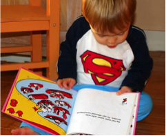 child reading picture book